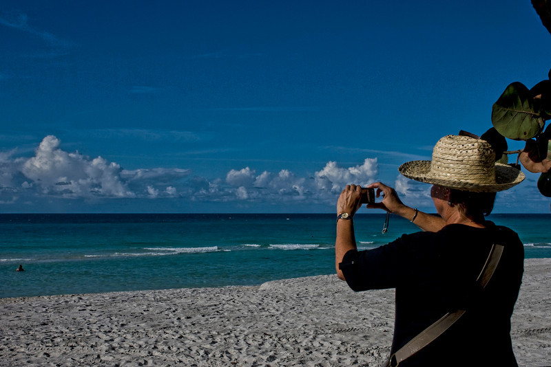 Cuba beach tourist with camera.jpg