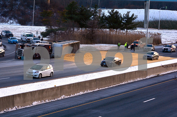 1/19/2018 Mike Orazzi | Staff The scene of semi truck that rollover and spilled grain on an entrance ramp to Interstate I84 in Southington near exit 28 Friday afternoon, causing delays in the area.