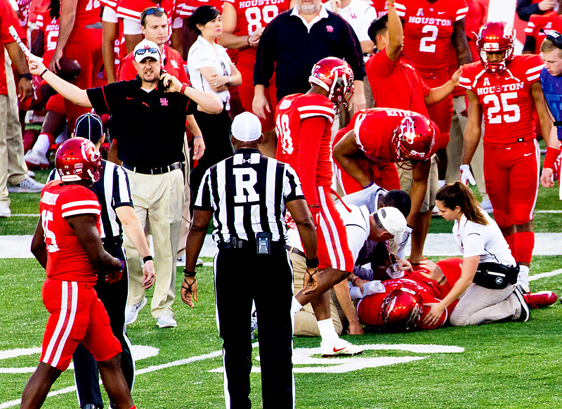 ... and breaks it.  He's out for several games.   (Look at Coach Herman's face.)