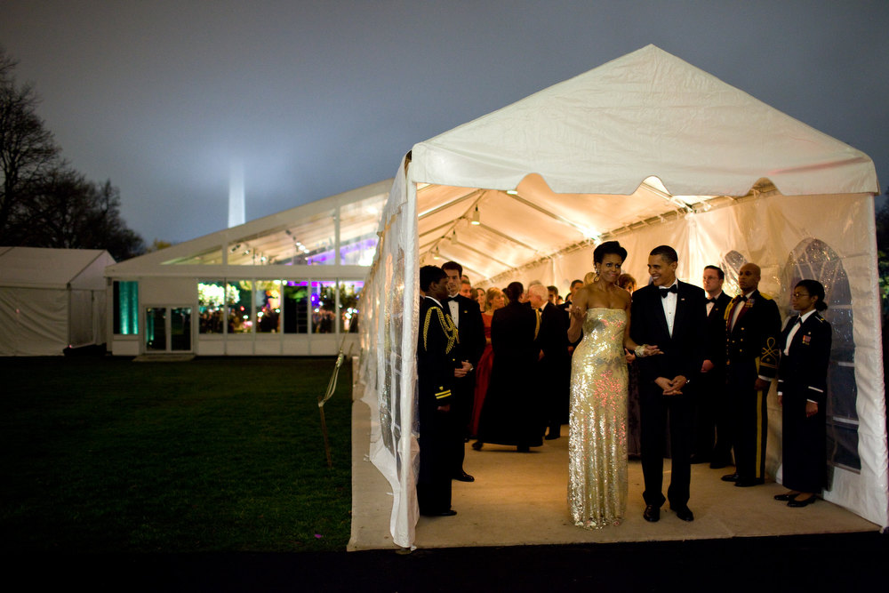 "Description of . Nov. 24, 2009 ""The President and First Lady wait for Indian Prime Minister Singh's motorcade to depart the White House at the conclusion of the first official state dinner for the Obama administration. The dinner was held in a tent on the South Lawn."" (Official White House photo by Pete Souza)"