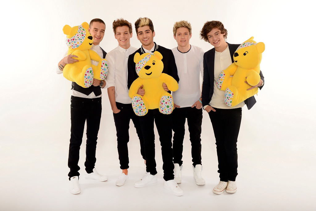 . Boy band One Direction, from left, Liam Payne, Louis Tomlinson, Zayn Malik, Niall Horan and Harry Styles are seen backstage at BBC\'s Children in Need at Television Centre on Friday, Nov. 16, 2012, in London. (Photo by Jon Furniss/Invision for Children in Need/AP Images)