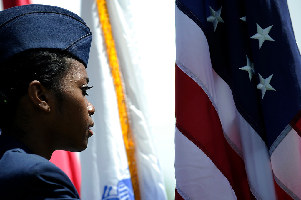 . Sr. Airmen Lorrena Slaton of the Civil Air Patrol stands at attention as she hold the American flag during a Memorial Day ceremony at Fort Logan Cemetery in Denver, Colorado on May 26, 2014. (Photo by Seth McConnell/The Denver Post)