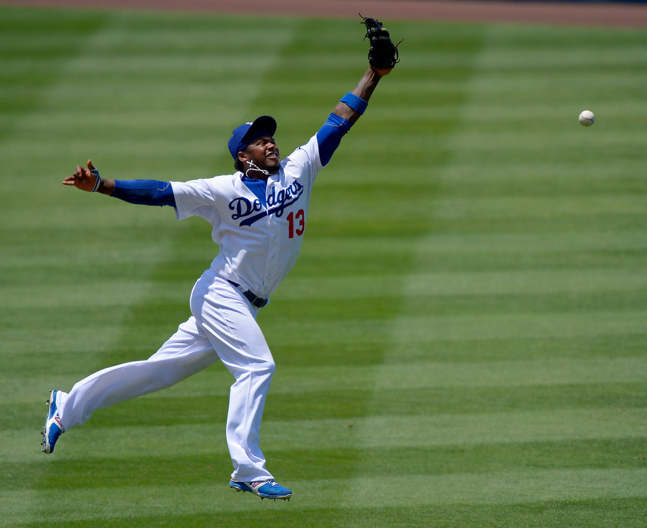 . Los Angeles Dodgers shortstop Hanley Ramirez cannot reach a ball hit for a single by Colorado Rockies\' Todd Helton during the fourth inning of a baseball game on Sunday, July 14, 2013, in Los Angeles. (AP Photo/Mark J. Terrill)