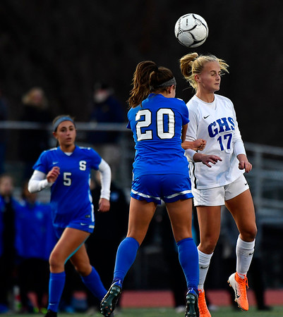 11/23/2019 Mike Orazzi | StaffrSouthington High Schools Katherine Crouse (20) and Glastonbury's Samantha Forrest (17) during the Class LL Girls State Soccer Tournament at Veterans Stadium in New Britain Saturday evening. Glastonbury won 1-0.
