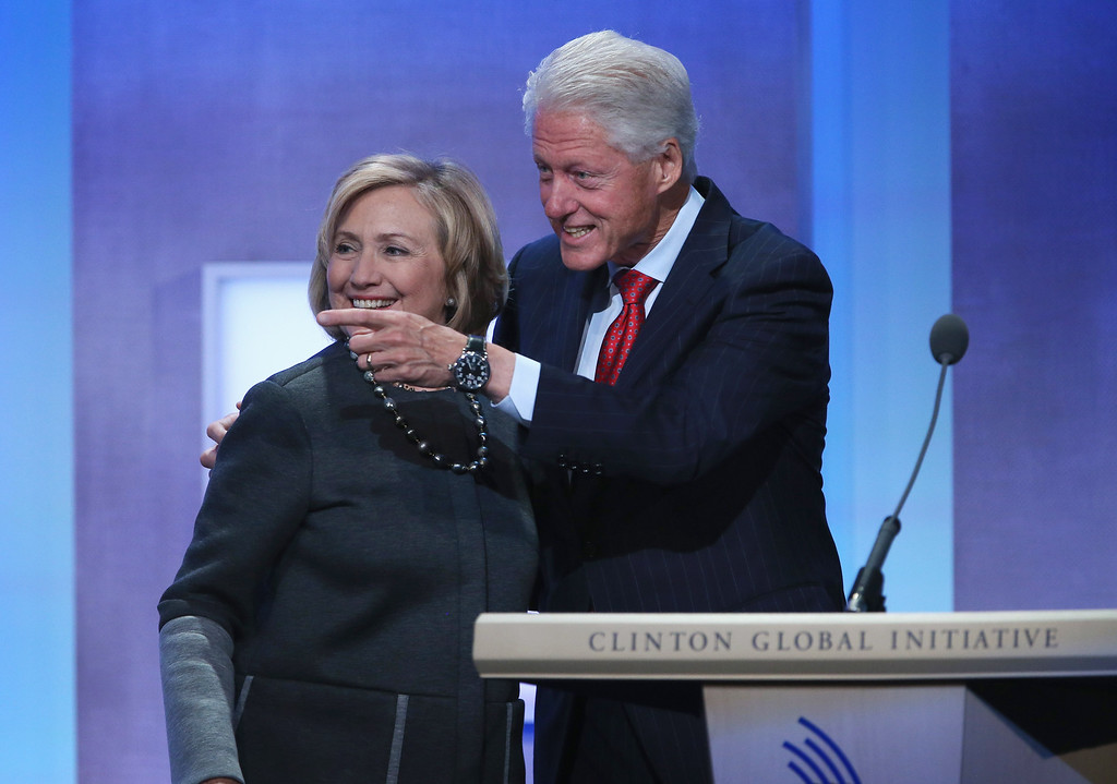 . Former Secretary of State Hillary Clinton (L) and former U.S. President Bill Clinton embrace at the opening plenary session of the Clinton Global Initiative (CGI), on September 22, 2014 in New York City.   (Photo by John Moore/Getty Images)