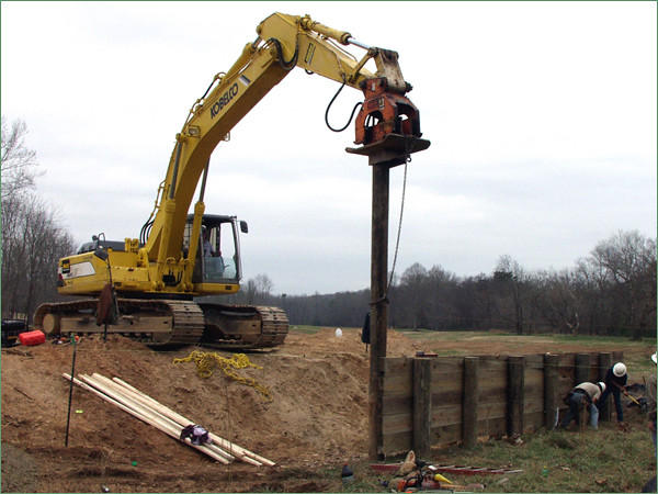 NPK C6C compactor on Kobelco excavator-pile driving.jpg