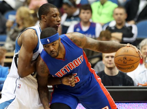 . Detroit Pistons\' Josh Smith. right, drives around Minnesota Timberwolves forward Thaddeus Young in the first quarter of an NBA basketball game, Thursday, Oct. 30, 2014, in Minneapolis. (AP Photo/Jim Mone)