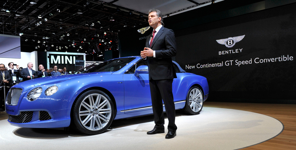 . Dr. Wolfgang Schreiber, Chairman and Chief Executive of Bentley, speaks next to the Continental GT Speed Convertible as it is unveiled at the North American International Auto Show in Detroit, Michigan January 14, 2013.  REUTERS/James Fassinger