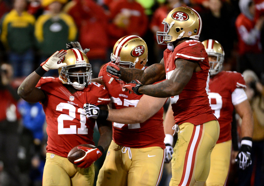 Description of . Running back Frank Gore #21 of the San Francisco 49ers celebrates with his teammates after scoring a touchdown in the fourth quarter against the Green Bay Packers during the NFC Divisional Playoff Game at Candlestick Park on January 12, 2013 in San Francisco, California.  (Photo by Harry How/Getty Images)