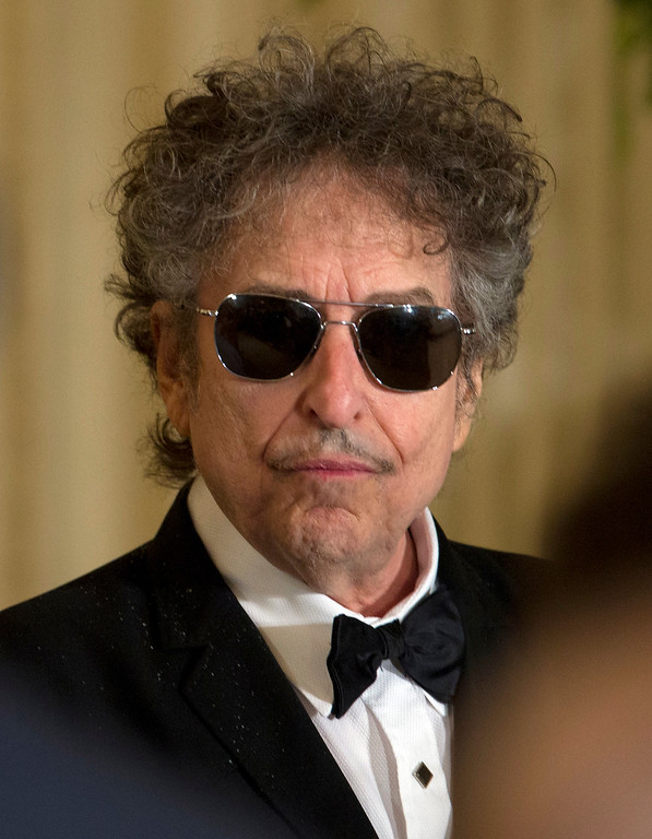 . FILE - Bob Dylan arrives for a ceremony to receive the Presidential Medal of Freedom in the East Room of the White House, in this May 29, 2012 file photo taken in Washington. Dylan couldn\'t be there to be inducted Wednesday May 15, 2013 into the American Academy of Arts and Letters, but his presence was felt in both letter and spirit. (AP Photo/Carolyn Kaster, File)