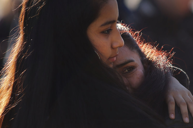 . Claudia Urbiana and daughter Jocelyne Cardenas (left) hug outside of the entrance to the Sandy Hook School on December 15, 2012 in Newtown, Connecticut. Twenty six people were shot dead, including twenty children, after a gunman identified as Adam Lanza opened fire at Sandy Hook Elementary School. Lanza also reportedly had committed suicide at the scene. A 28th person, believed to be Nancy Lanza was found dead in a house in town, was also believed to have been shot by Adam Lanza.  (Photo by Spencer Platt/Getty Images)
