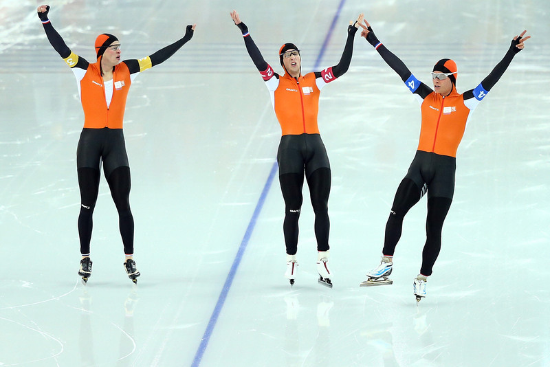 . (L to R) Sven Kramer, Jan Blokhuijsen and Koen Verweij of the Netherland celebrate winning the gold medal during the Men\'s Team Pursuit Final A Speed Skating event on day fifteen of the Sochi 2014 Winter Olympics at  at Adler Arena Skating Center on February 22, 2014 in Sochi, Russia.  (Photo by Ryan Pierse/Getty Images)