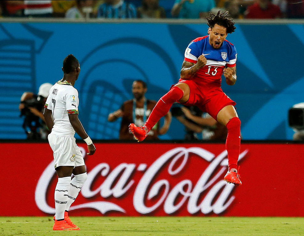 . Ghana\'s Christian Atsu, left, looks back at his net as United States\' Jermaine Jones celebrates a goal by Clint Dempsey during the group G World Cup soccer match between Ghana and the United States at the Arena das Dunas in Natal, Brazil, Monday, June 16, 2014. (AP Photo/Julio Cortez)