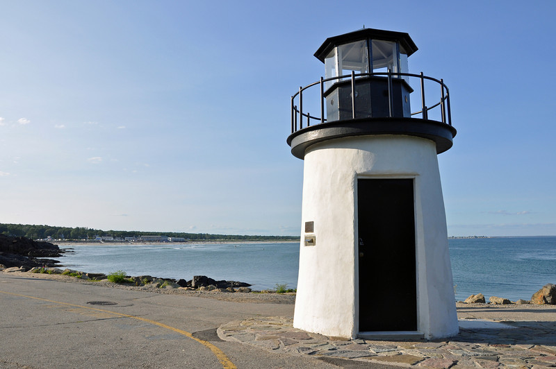 This lighthouse has three names that we know of - Little Lighthouse, Lobster Point Lighthouse and Marginal Way Lighthouse.  It is in the town of Ogunquit, Maine.  It is little.  There are so many lobster traps and lobster ponds in the area and it is on the Marginal Way walking path.  So each name does make sense!