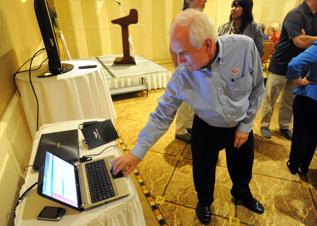 . Torrance mayoral candidate Tom Brewer checks a computer for updates in results at his election night party at the Doubletree Hotel in Torrance, CA on Tuesday, June 3, 2014. (Photo by Scott Varley, Daily Breeze)