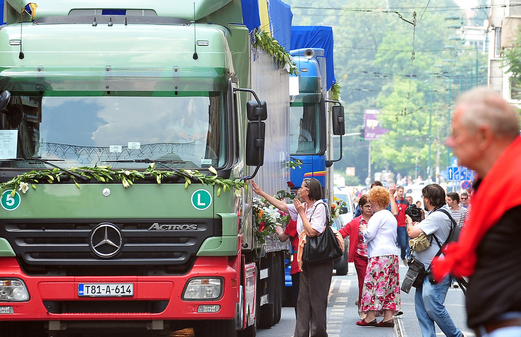 . Bosnians line up in the main street of Sarajevo to honor the remains of victims of the Srebrenica Massacre of 1995 as they are driven by in trucks, and shipped from a municipal morgue in the Central-Bosnian town of Visoko, on July 9, 2013, in preparation for mass burial, at Potocari Memorial cemetery near the Eastern-Bosnian town of Srebrenica, on July 11. Potocari Memorial cemetery is undergoing preparations for another mass burial on July 11, when 408 newly identified bodies will be put to final rest. Bodies are identified as those belonging to Bosnian Muslim victims, of the offensive undertaken by Bosnian Serbs in July 1995 with aim to occupy the earlier declared UN safe haven area of Srebrenica and the surrounding villages. During the offensive more than 8000 Bosnian non-Serbs went missing to be found buried in mass graves years after the war ended.  ELVIS BARUKCIC/AFP/Getty Images