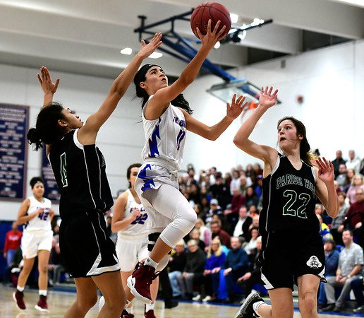 2/28/2019 Mike Orazzi | Staff St. Paul Girls Basketball's Janessa Gonzalez (11) during the Class S Second Round State Girls Basketball Tournament with Parish Hill in Bristol Thursday night.