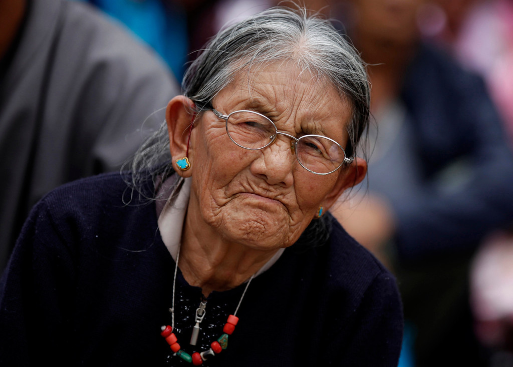 ". An elderly Tibetan woman listens to spiritual leader the Dalai Lama during an event organized to celebrate his 78th birthday in Bylakuppe, about 220 kilometers (137 miles) southwest of Bangalore , India, Saturday, July 6, 2013. Speaking after an interfaith meeting, he said 150,000 Tibetans living abroad represent ""6 million Tibetans (in China) who have no freedom or opportunity to express what they feel.\"" (AP Photo/Aijaz Rahi)"