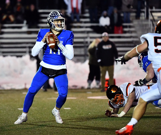12/4/2019 Mike Orazzi | StaffrSouthingtons Brady Lafferty (15) during the Class LL football playoff with Ridgefield at Southington High School on Wednesday night. r