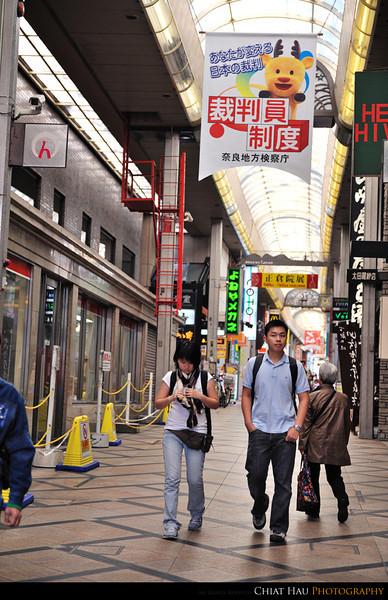 Hong Wei and Huie Chien... walking along the street