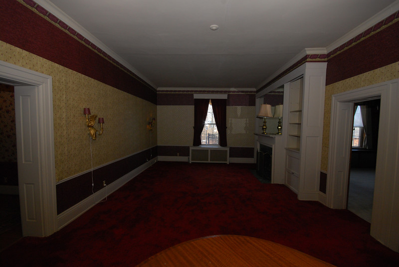 The piano is in the foreground; the dining room is at left, the TV room is at right.