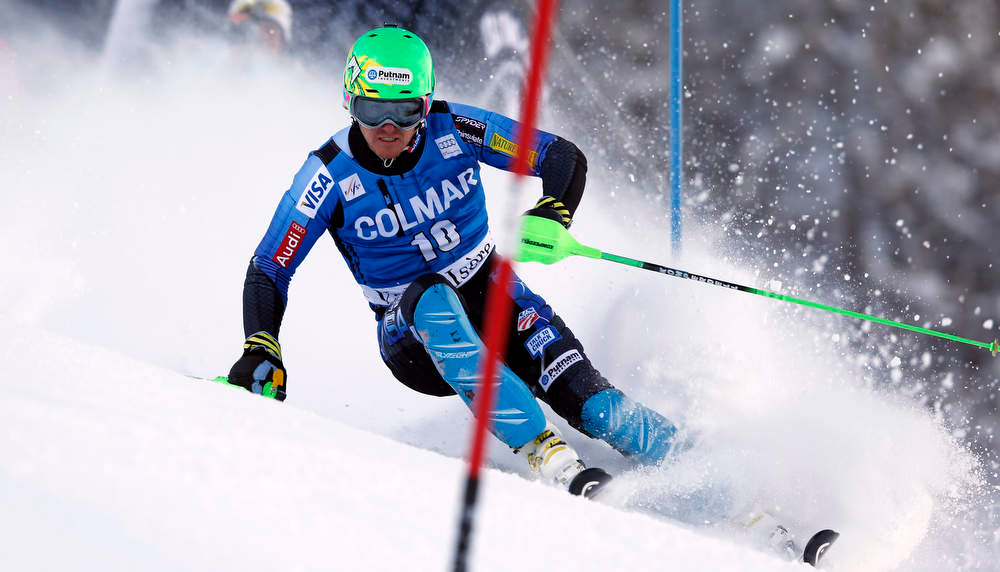 Description of . Ted Ligety of the United States competes during the first run of an alpine ski, men's World Cup slalom in Val d'Isere, France, Saturday, Dec. 8, 2012. (AP Photo/Alessandro Trovati)
