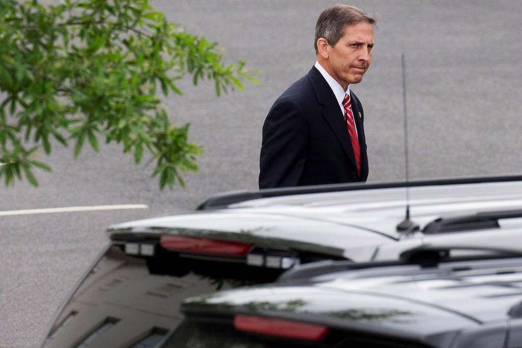 . Deputy Veterans Affairs Secretary Sloan Gibson leaves the White House in Washington, Friday, May 30, 2014, after being named by President Barack Obama to run the Veterans Affairs Department on an interim basis while Obama searches for a replacement for Veterans Affairs Secretary Eric Shinseki who resigned Friday. (AP Photo/Jacquelyn Martin)