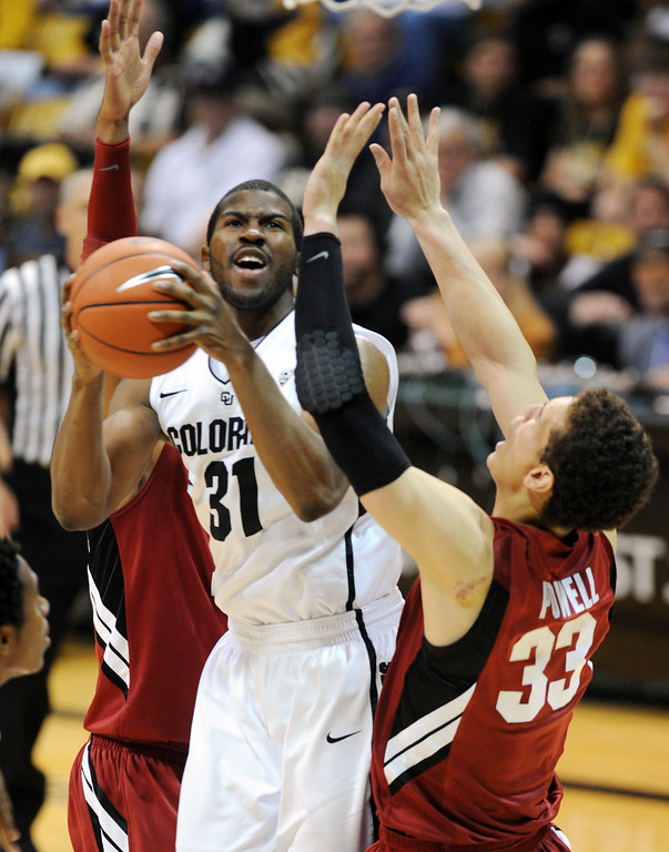 . Jeremy Adams of CU goes up on Dwight Powell of Stanford during the second half of the January 24th, 2013 game in Boulder. For more photos of the game, go to www.dailycamera.com. Cliff Grassmick / January 24, 2013