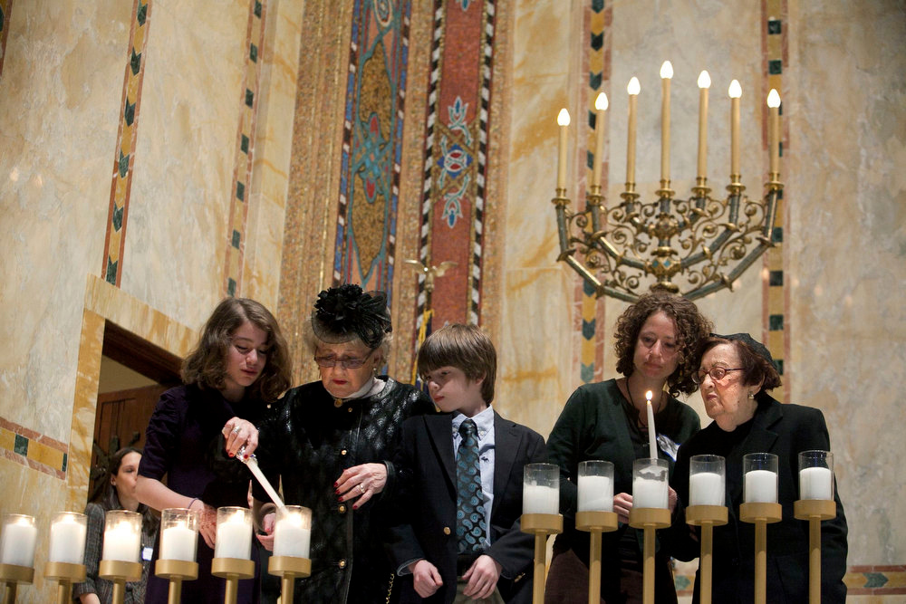 Description of . Holocaust survivors light symbolic candles at the Temple Emanu-El during the annual Holocaust Remembrance Day in New York on April 7, 2013. The day brings together Holocaust survivors and their families to remember the 6 million Jews who were murdered during the Holocaust. REUTERS/Allison Joyce