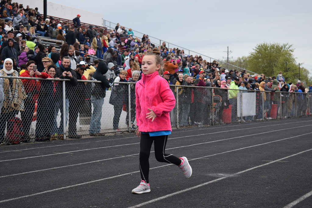 . Briana Contreras � The Morning Journal <br> Nyla Messer, a second-grader at Forestlawn Elementary School in Sheffield Lake, makes her way to the finish line during the 50 Meter Dash Race at the 38th Annual Lorain County Special Olympics Track and Field Event held on May 11 at Ely Stadium in Elyria. This was Nyla\'s third year participating in the Special Olympics.