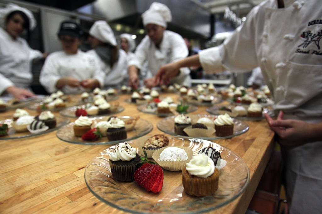 . Mt. Diablo High School students prepare dessert plates in the kitchen at Serendipity Restaurant in Concord at 12:12pm on Wednesday, Dec. 12, 2012. The Restaurant located on the campus of high school is open three days a week to the public and is staffed by students. (Anda Chu/Staff)