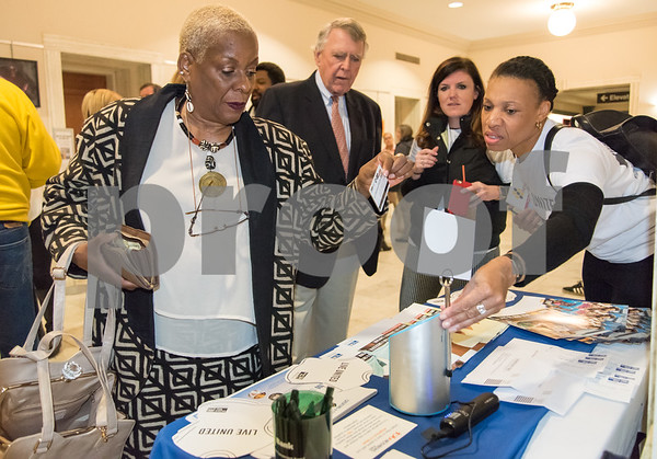 11/21/17 Wesley Bunnell | Staff A conference was held Tuesday morning at New Britain City Hall between the city and The United Way announcing a program where city employees can elect to have a portion of their paycheck automatically donated to The United Way. Executive Director of OIC New New Britain Paulette Fox swipes her card at the dip jar machine to make a donation with the help of United Way Partnership Manager Mona Brewster.