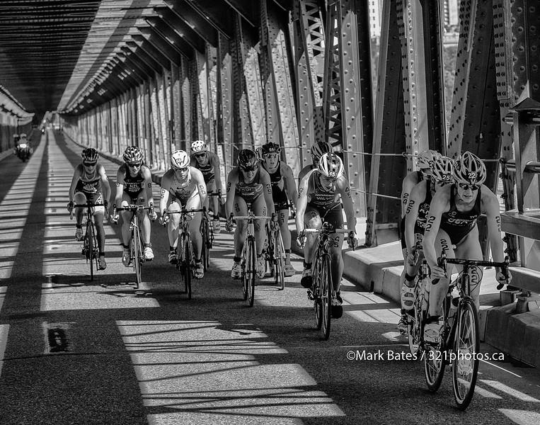 Paula Findlay in the lead bike pack crossing a covered bridge