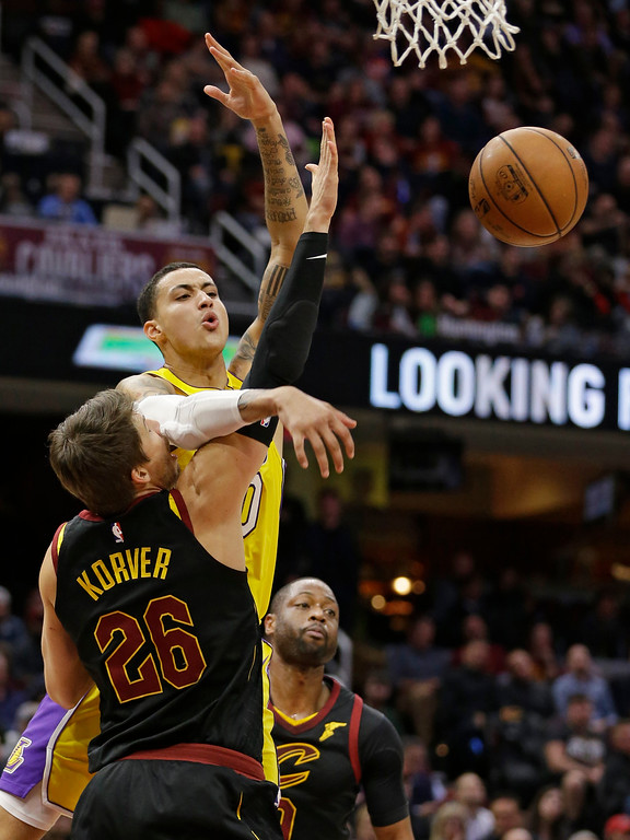 . Cleveland Cavaliers\' Kyle Korver, left, knocks the ball loose from Los Angeles Lakers\' Kyle Kuzma in the second half of an NBA basketball game, Thursday, Dec. 14, 2017, in Cleveland. The Cavaliers won 121-112. (AP Photo/Tony Dejak)