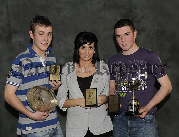 Clinton McKeever receives the Past Pupils Association Award for Attendance and Michelle Reel and Michael Quinn receive their awards for Work Experience 10W45N604