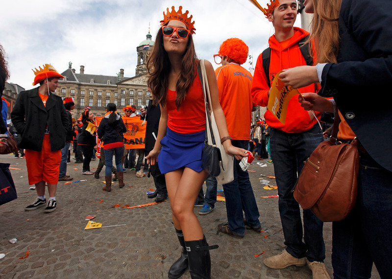 . A woman celebrates the new Dutch King Willem-Alexander who succeeds his mother Queen Beatrix, in Amsterdam\'s Dam Square April 30, 2013. Queen Beatrix of the Netherlands abdicated on Tuesday, handing over to her eldest son, Willem-Alexander, who became the first King of the Netherlands in over 120 years.  REUTERS/Cris Toala Olivares
