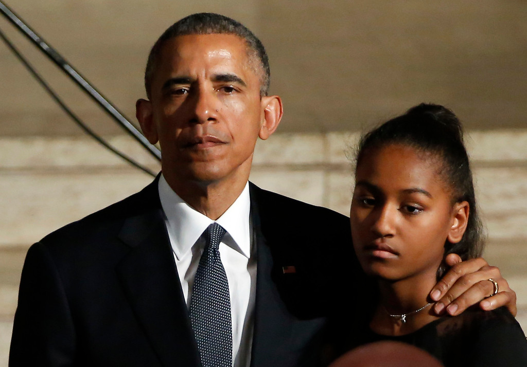 . US President Barack Obama hugs his daughter Sasha during funeral services for Vice President Joe Biden\'s son, Beau Biden, Saturday, June 6, 2015,  at St. Anthony of Padua Church in Wilmington, Del. Obama delivered the eulogy for Vice President Joe Biden\'s son, Beau, who lost his battle with brain cancer at age 46. (Yuri Gripas/Pool Photo via AP)