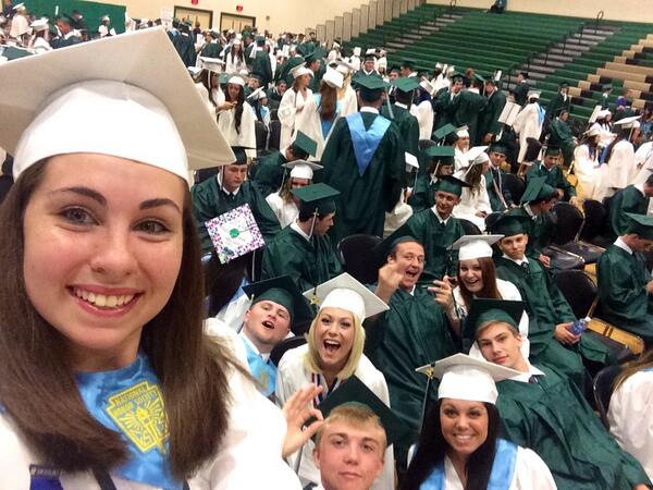 Description of . Molly Donegan takes a selfie at Ridley High School's graduation.