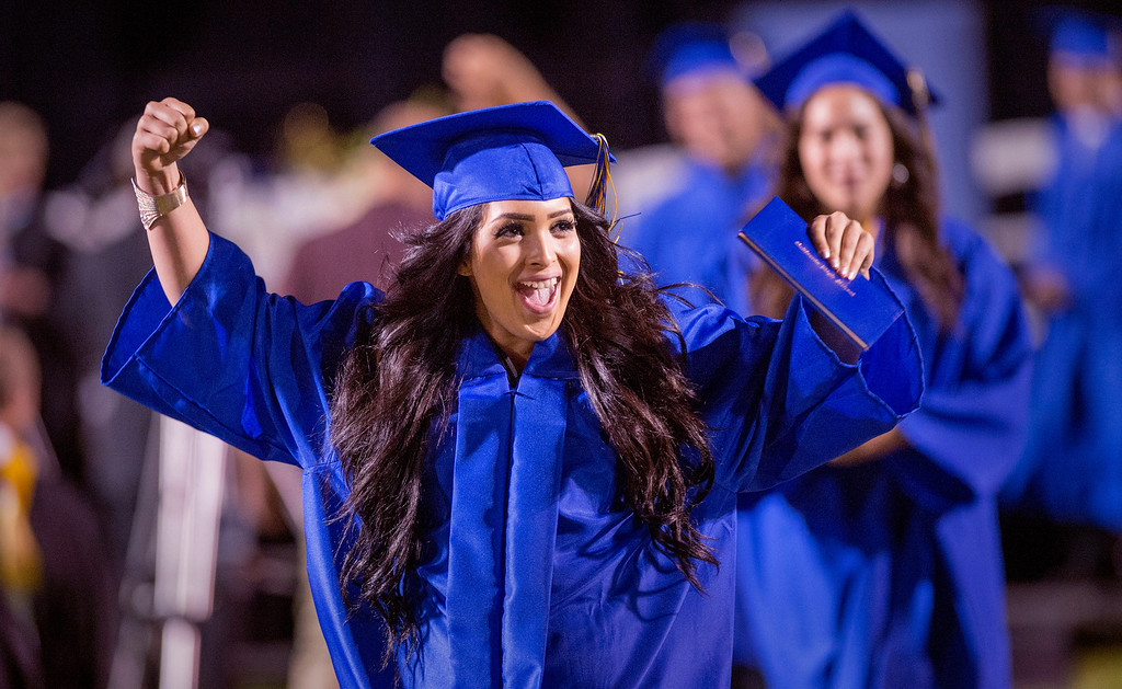 . A jubilant Cesley Sanchez receives her diploma during California High graduation at their Whittier campus stadium June 13, 2013.   (SGVN staff photo by Leo Jarzomb)