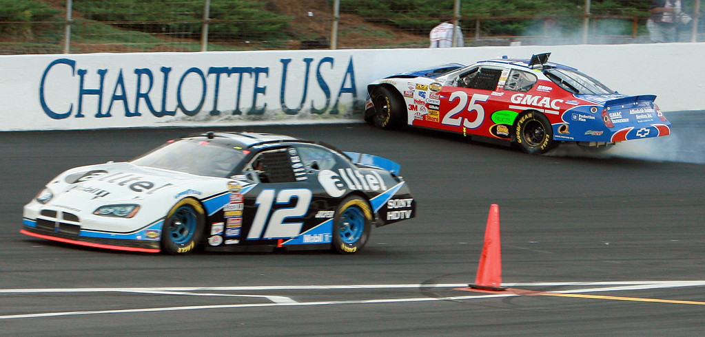 . Brian Vickers (25) crashes as Ryan Newman (12) drives past during the NASCAR Nextel Cup Series Coca-Cola 600 auto race at Lowe\'s Motor Speedway in Concord, N.C., Sunday, May 28, 2006. (AP Photo/Ron Fischer)