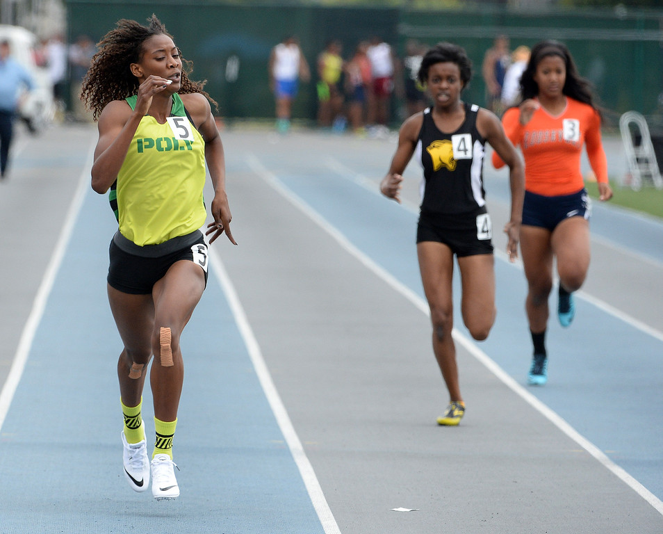 . Long Beach Poly\'s Kaelin Roberts win the division 1 400 meters race during the CIF Southern Section track and final Championships at Cerritos College in Norwalk, Calif., Saturday, May 24, 2014.   (Keith Birmingham/Pasadena Star-News)