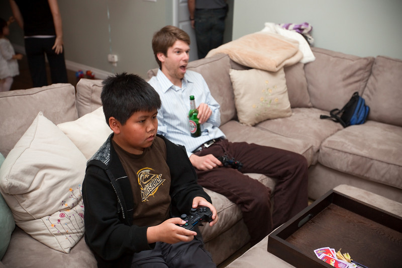 Tommy looks serious as he plays games...Jesse quite the opposite