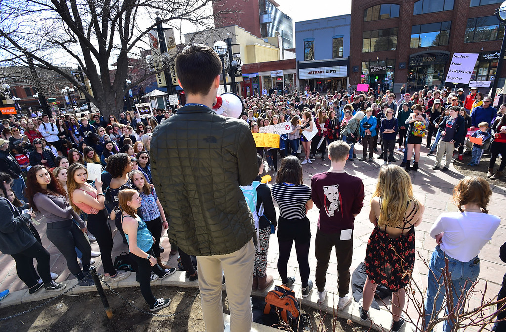 . Alec Eyl talks to the assembled crowd at the Boulder County Courthouse on the Pearl Street Mall during a walkout by Boulder High School and other students to protest gun violence on Wednesday morning.  For more photos go to dailycamera.com Paul Aiken Staff Photographer March 14, 2018.