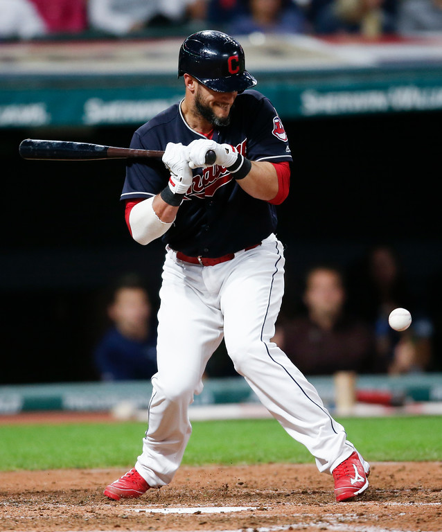 . Cleveland Indians\' Yan Gomes reacts after being hit by a pitch from Minnesota Twins starter Adalberto Mejia with the bases loaded during the fourth inning in a baseball game, Wednesday, Sept. 27, 2017, in Cleveland. (AP Photo/Ron Schwane)