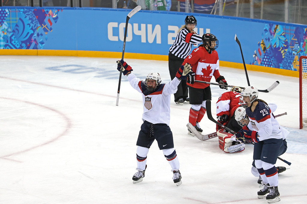 . Kelli Stack #16 of the United States celebrates a goal in the second period against Canada during the Women\'s Ice Hockey Preliminary Round Group A game on day five of the Sochi 2014 Winter Olympics at Shayba Arena on February 12, 2014 in Sochi, Russia.  (Photo by Bruce Bennett/Getty Images)