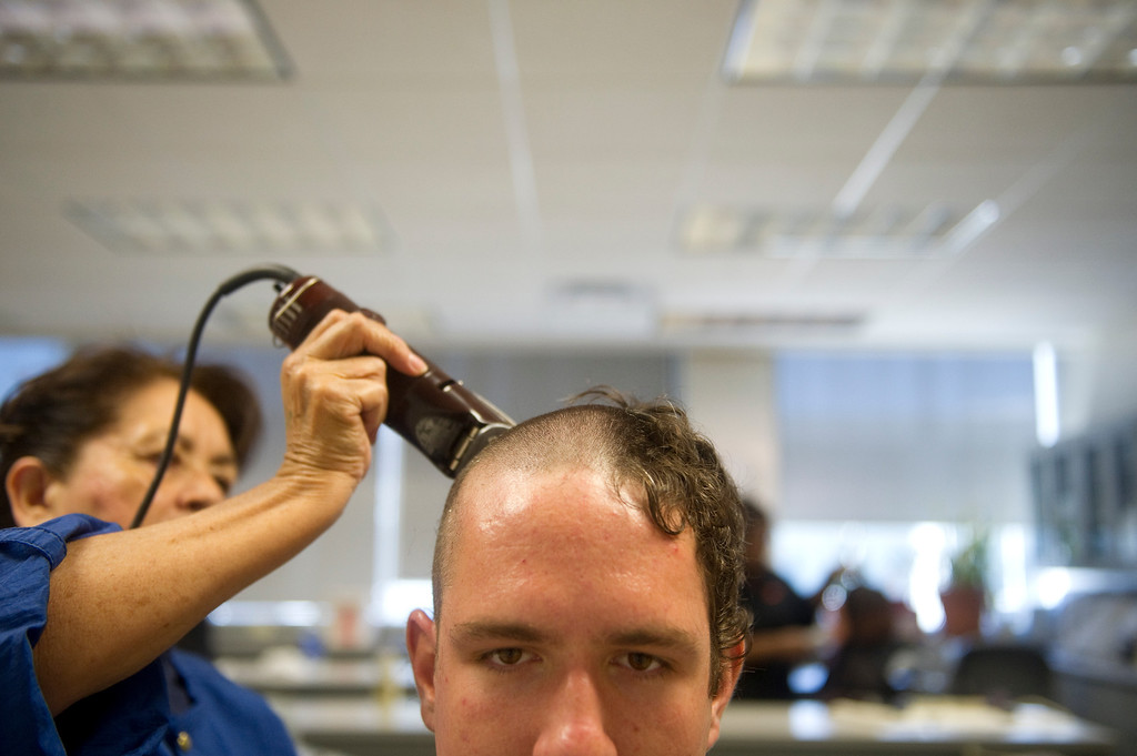 . COLORADO SPRINGS, CO. - JUNE 27: Basic Cadet Trainee Allen Caunitz has his hair buzzed off during inprocessing of the class of 2017 at the Air Force Academy on June 27, 2013. Nearly 1000 trainees were processed on Thursday.