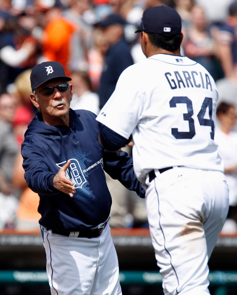 . Manager Jim Leyland #10 of the Detroit Tigers greets Avisail Garcia #34 after their 6-1 win over the Minnesota Twins. Garcia, pinch hitting for Don Kelly, hit a bases loaded triple in the sixth inning. (Photo by Duane Burleson/Getty Images)