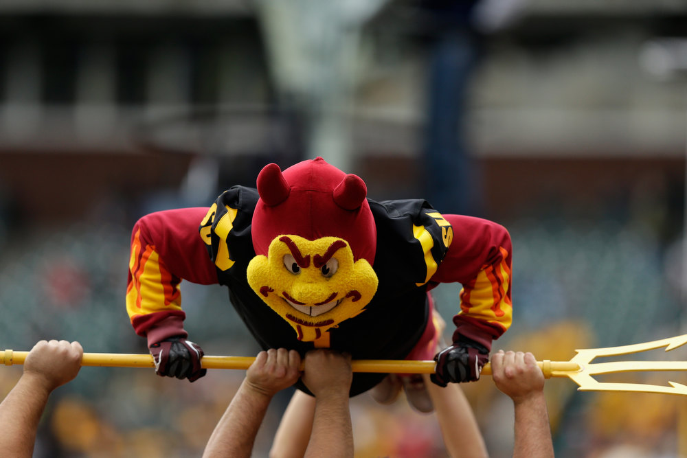 Description of . Sparky, the Arizona State Sun Devils mascot, does push ups after the Sun Devils scored  during the Kraft Fight Hunger Bowl against the Navy Midshipmen at AT&T Park on December 29, 2012 in San Francisco, California.  (Photo by Ezra Shaw/Getty Images)