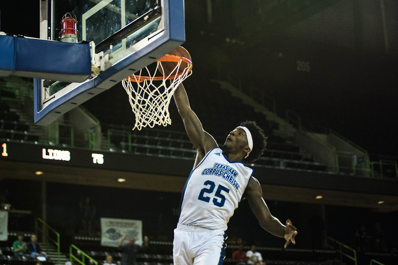 Islander's Rashawn Thomas dunks during the basketball game against the Southern Louisiana Lions.