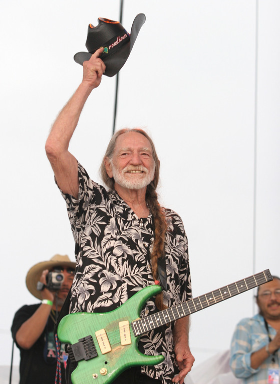 . Willie Nelson raises his hat to the fans attending his Fourth of July Picnic in this July 4, 2006 file photo, in Ft. Worth, Texas.   (AP Photo/Rex C. Curry, file)